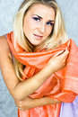 Blond in coral scarf Royalty Free Stock Photography