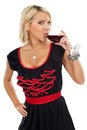 Blond drinking red wine Stock Photography