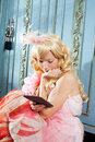 Blond fashion princess woman reading ebook tablet Stock Photos