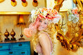 Blond fashion woman with spring flowers hat Royalty Free Stock Photo