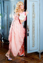 Blond fashion woman vintage in wardrobe pink dress Royalty Free Stock Images