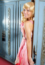 Blond fashion woman vintage in wardrobe pink dress Royalty Free Stock Photos
