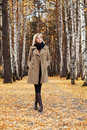 Blond fashion woman walking in autumn forest Royalty Free Stock Photo
