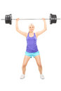 Blond female athlete lifting a heavy barbell full length portrait of isolated on white background Stock Photo