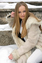 Blond freckled girl in fur coat Stock Photo