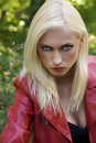Blond girl anger in park Royalty Free Stock Photos