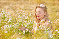 Blond girl on the camomile field beautiful at pretty looking woman meadow of daisy flowers cute young lady relaxing outdoor having Stock Photography