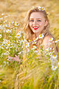 Blond girl on the camomile field beautiful at pretty looking woman meadow of daisy flowers cute young lady relaxing outdoor having Royalty Free Stock Photography