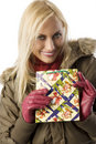 Blond girl with christmas bag Royalty Free Stock Photos