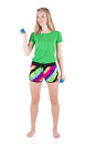 Blond girl in colourful sportswear standing with legs on shoulders width keeping blue dumbbells in hands Royalty Free Stock Photo