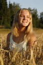 Blond girl enjoying the evening sunlight Stock Photos