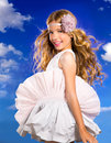 Blond girl with fashion dress blowing hair in blue sky happy and wind a background Royalty Free Stock Photo