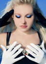 Blond girl in gloves Stock Photo