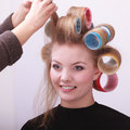 Blond girl hair curlers rollers hairdresser salon beautiful young women in beauty with by hairstyle Stock Image