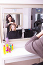 Blond girl hair curlers rollers hairdresser salon beautiful young women in beauty with by hairstyle reflection in mirror Royalty Free Stock Photo