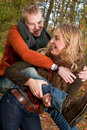 Blond girl and her boyfriend happy young couple is having a nice time in october Royalty Free Stock Photography