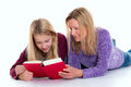 Blond girl and her mother using tablet PC Royalty Free Stock Photo
