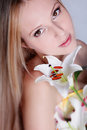 Blond girl with lily flower Stock Photos