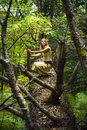 Blond girl in a magic forest Royalty Free Stock Photography