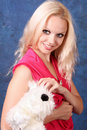 Blond girl in pink   with   dog Royalty Free Stock Images
