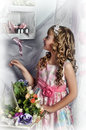 Blond girl in a pink dress with flowers Royalty Free Stock Photo