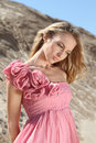 Blond girl in the pink dress with roses Royalty Free Stock Photos