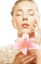 Blond girl with pink flower on white background young beautiful healthy Stock Photography