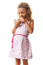 Blond girl playing smartphone cute little touching the display dialing or using isolated on white Royalty Free Stock Photo