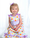 Blond Girl in Polka Dot Dress Royalty Free Stock Image