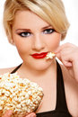 Blond girl with popcorn Royalty Free Stock Photo