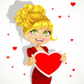 Blond girl in red evening dress shows valentine banner Stock Photo