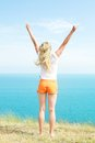 Blond girl in shorts Stock Photos