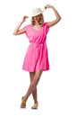 Blond girl in summer pink clothing isolated on the white Stock Photography