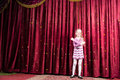 Blond Girl Wearing Clown Make Up Standing on Stage Royalty Free Stock Photo