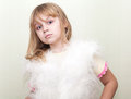 Blond girl wears white fluffy fur vest Royalty Free Stock Photo