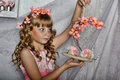 Blond girl with white flowers in her hair russian long haired and pink dress Stock Photos