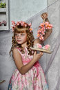 Blond girl with white flowers in her hair russian long haired and pink dress Royalty Free Stock Photo
