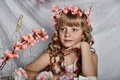 Blond girl with white flowers in her hair russian long haired and pink dress Royalty Free Stock Photography