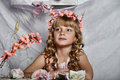 Blond girl with white flowers in her hair russian long haired and pink dress Royalty Free Stock Photos