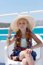 Blond girl on a yacht in the Hat Royalty Free Stock Image