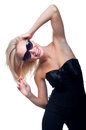 Blond in glasses on white funny beautiful young woman model wearing stylish black top with big silk bow black trausers and sun Stock Images