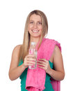 Blond gril with water bottle and a towel playing sport isolated on white background Royalty Free Stock Photo