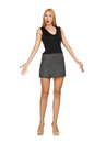 The blond hair model wearing gray skirt isolated on white Stock Photography
