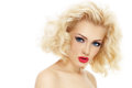 Blond hair young beautiful woman with curly and stylish make up over white background Royalty Free Stock Photography