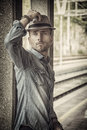 Blond handsome young man with fedora hat Royalty Free Stock Photo