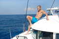 Blond handsome young man on sailing boat Royalty Free Stock Images