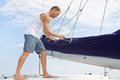 Blond handsome young man on sailing boat attractive standing a Stock Image