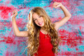 Blond happy children girl in red happy arms up with grunge background Stock Photos