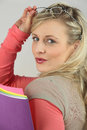 Blond holding folders seductive lots of Royalty Free Stock Photography