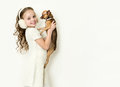Blond kid girl with small pet dog blondy Stock Image